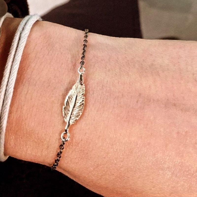 bracciale in argento 925 con piuma in oro